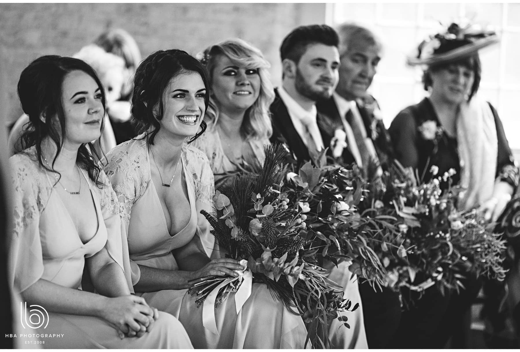 bridesmaids smiling during the ceremony