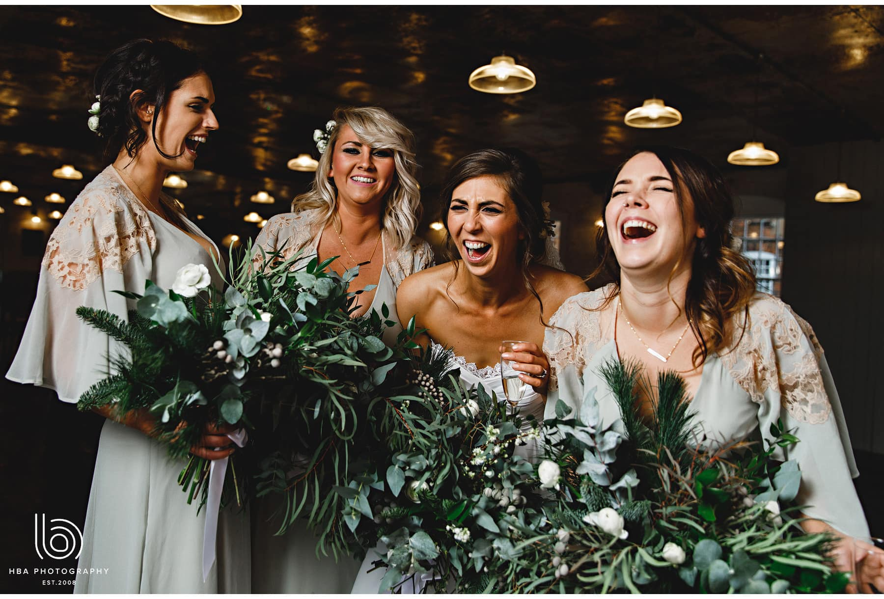 the bride and her girls laughing