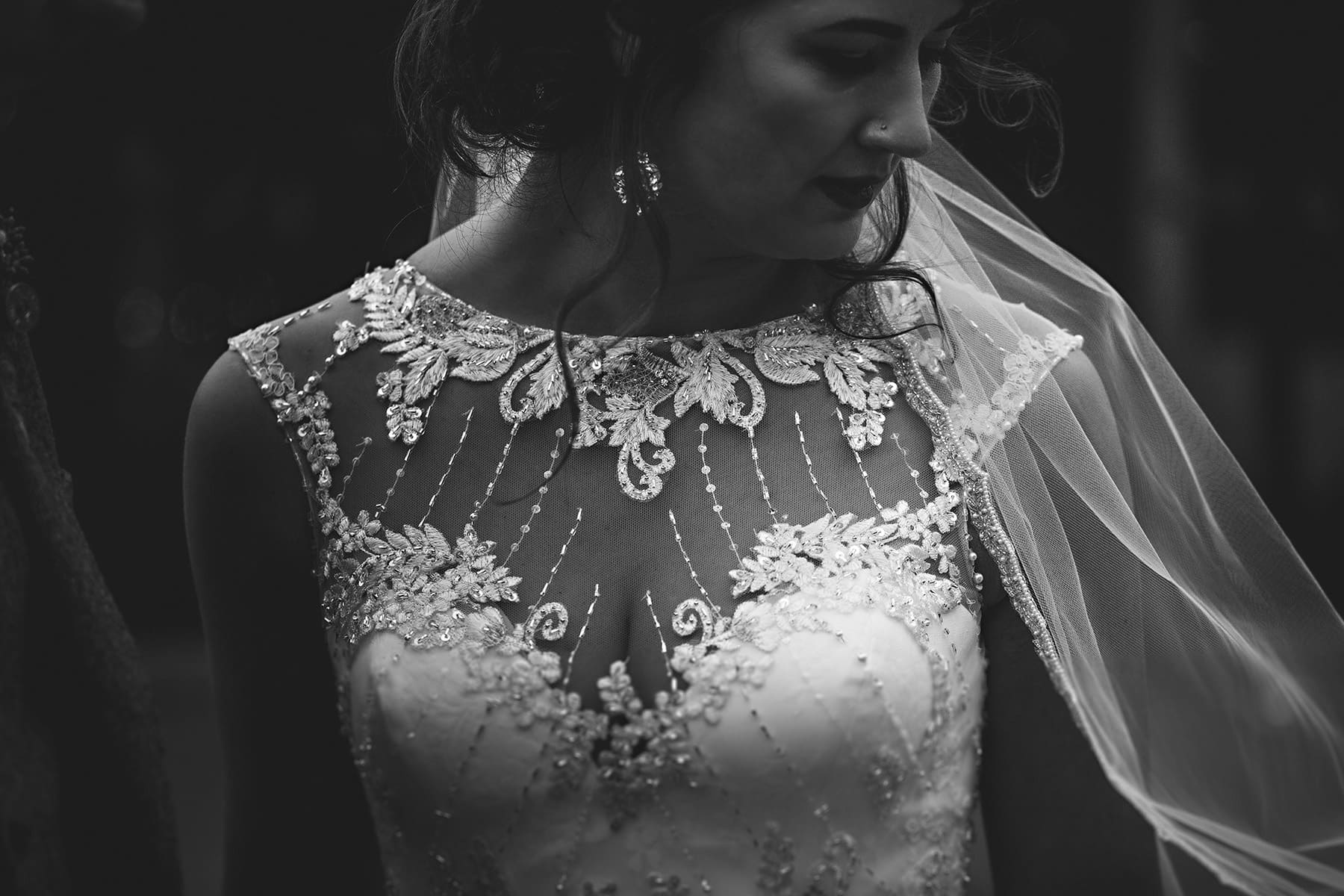 the bride looking at her viel in black and white at The Mill Barns in Shropshire
