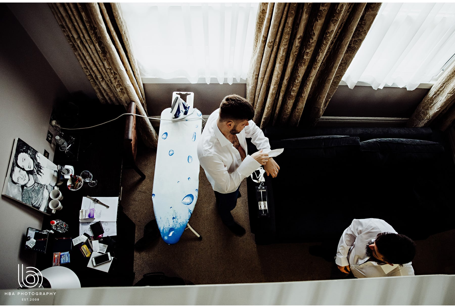the groom ironing
