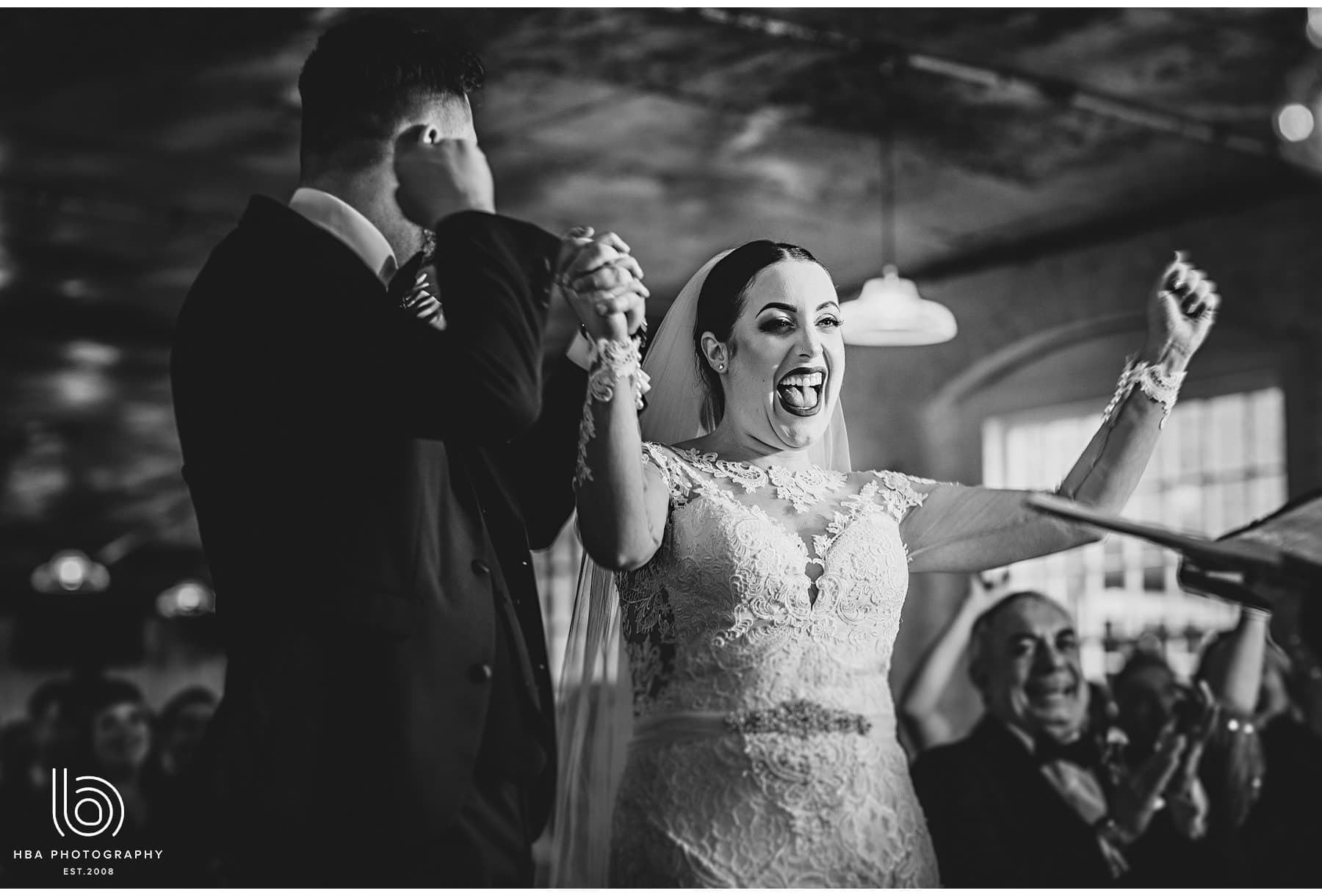 the bride cheering during the ceremony