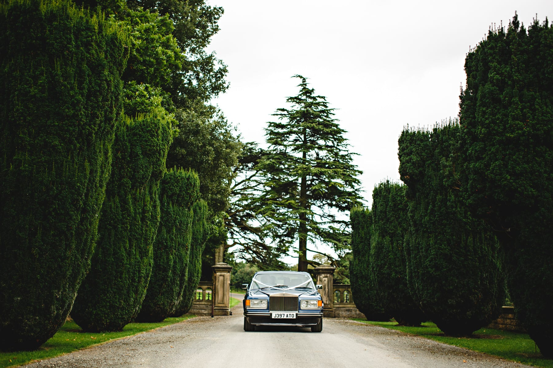 the wedding car arriving Osmaston Park in Derbyshire