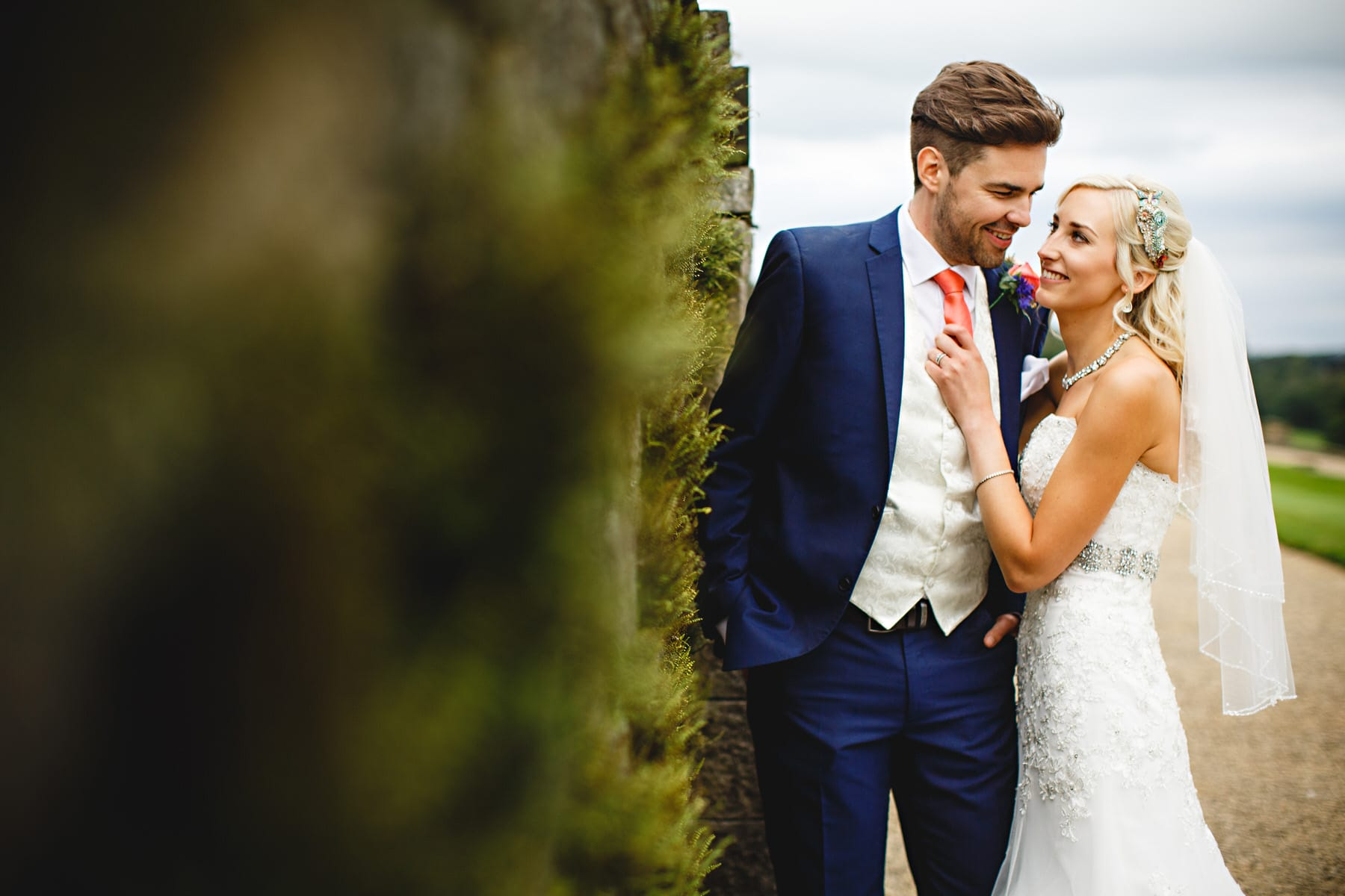 bride and groom stood against the walls at Osmaston Park in Derbyshire