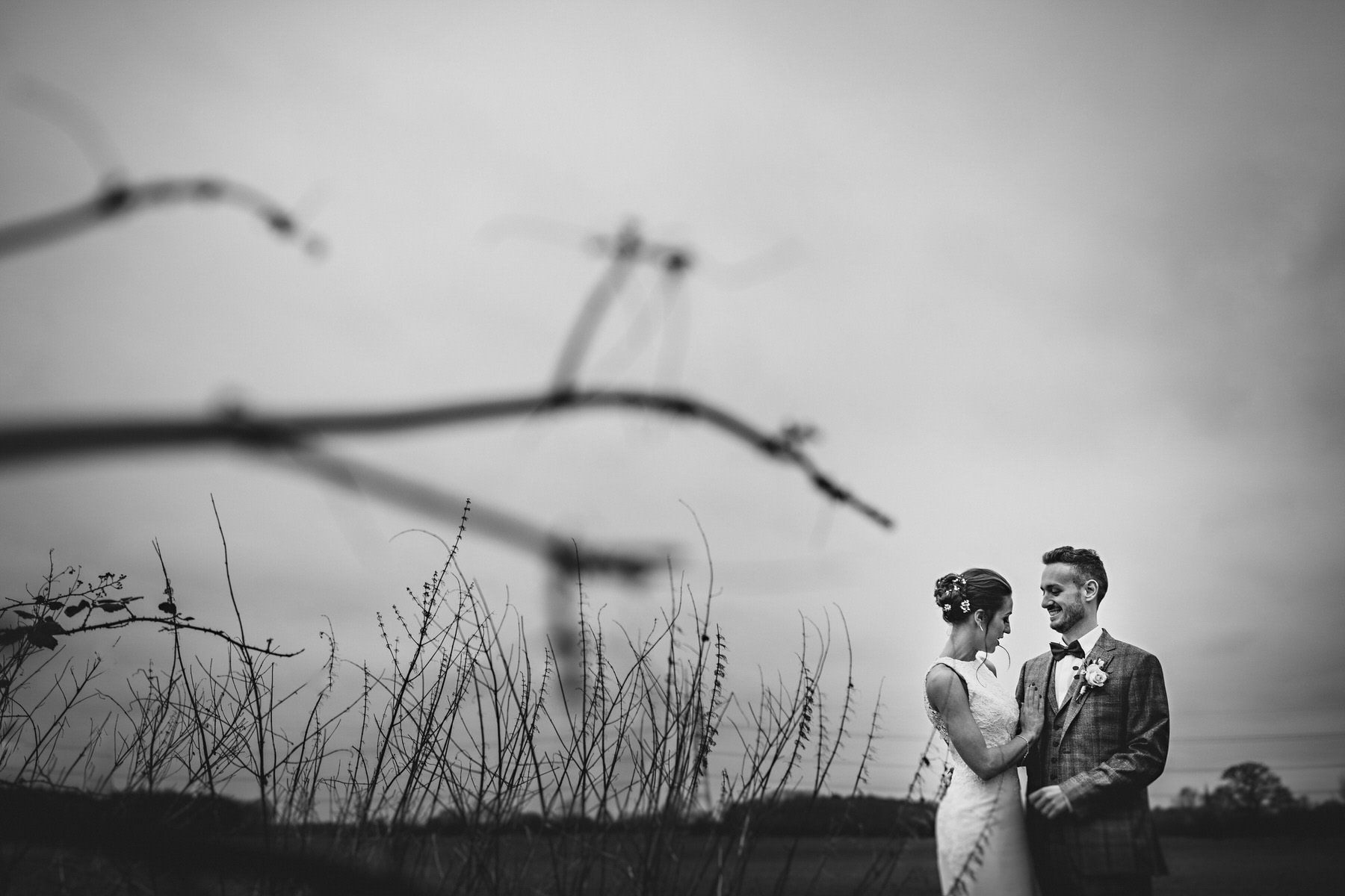 the bride and groom in the corn field at Shustoke Barns in Warwickshire