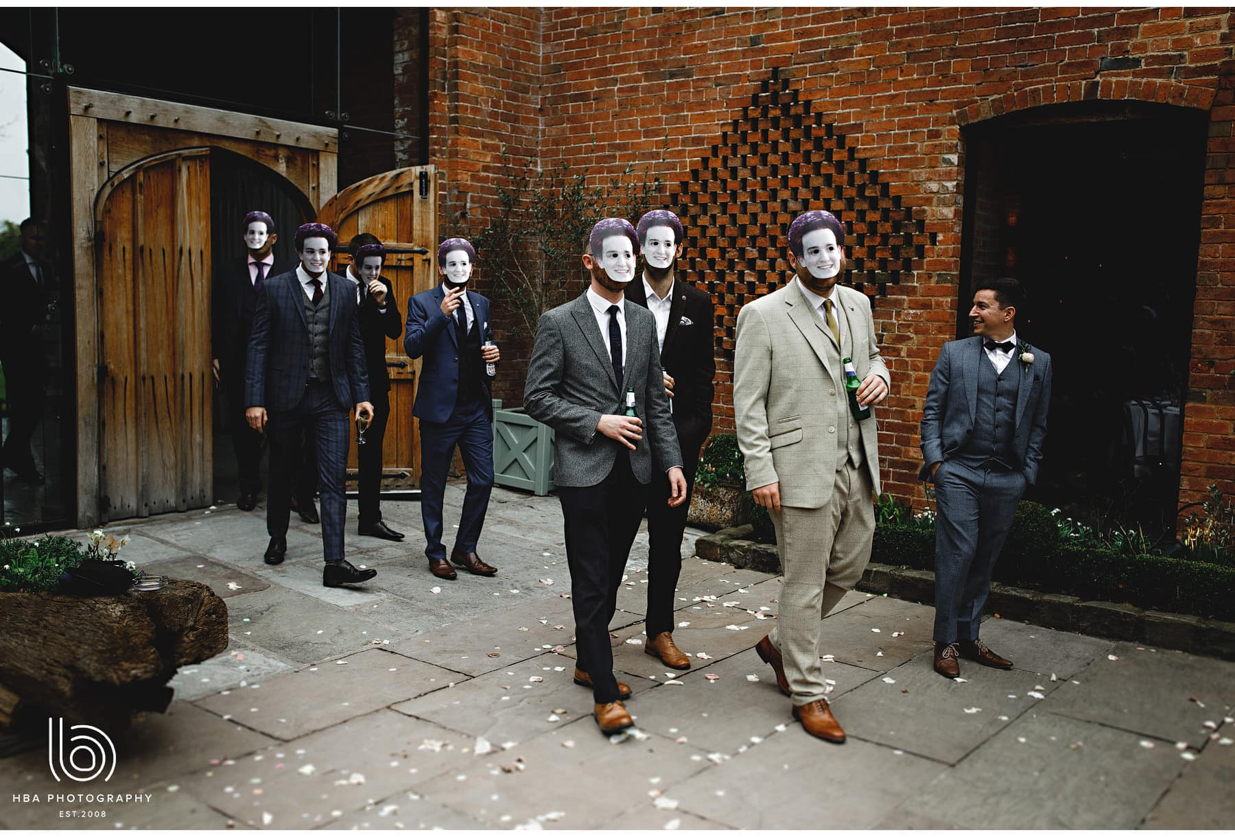 all the groom's mates wearing the groom's face as masks