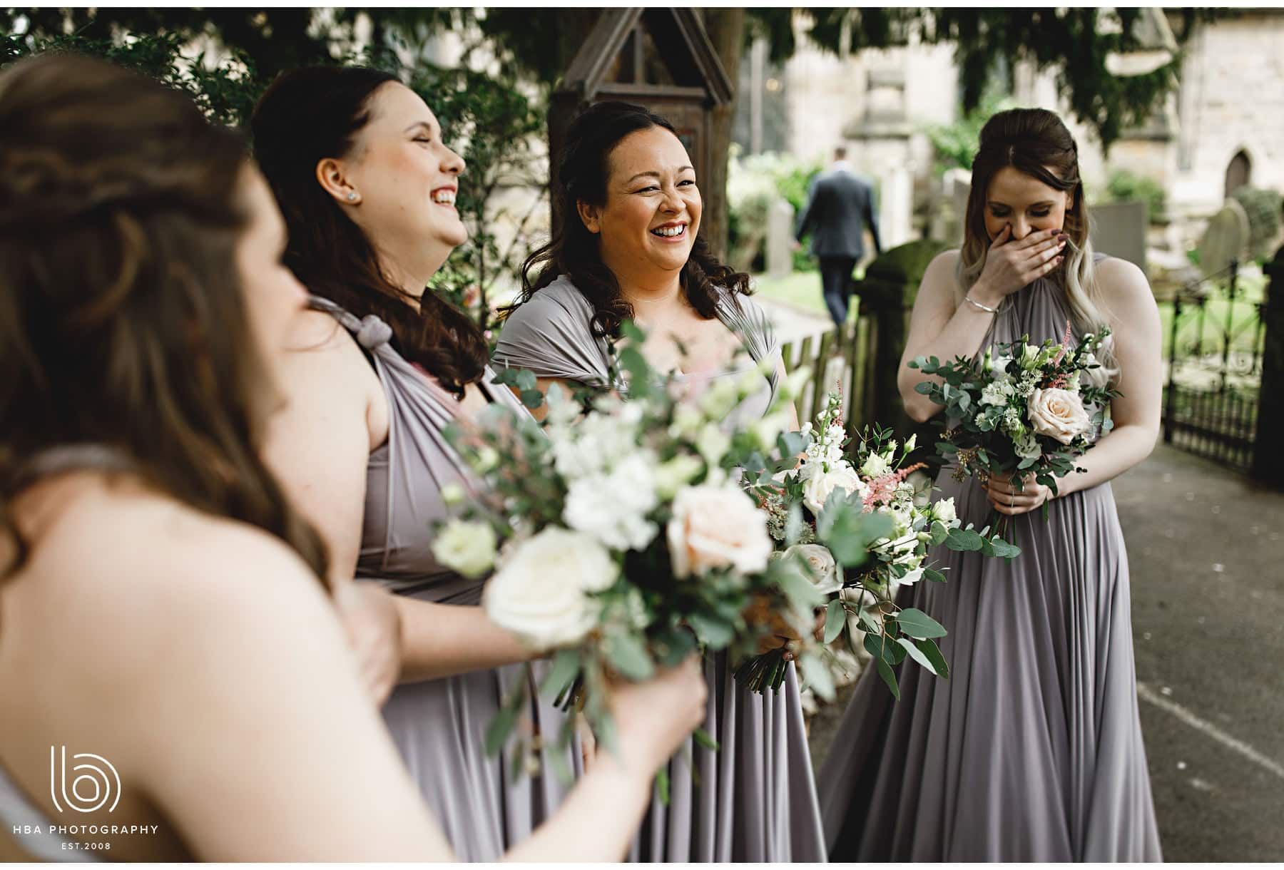 the bridesmaids smiling