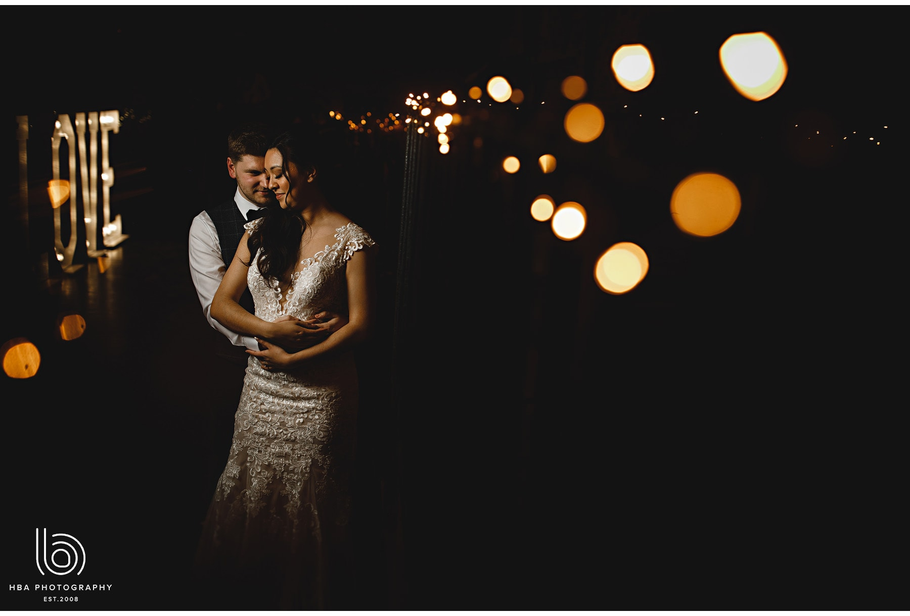 bride and groom in the fairy lights