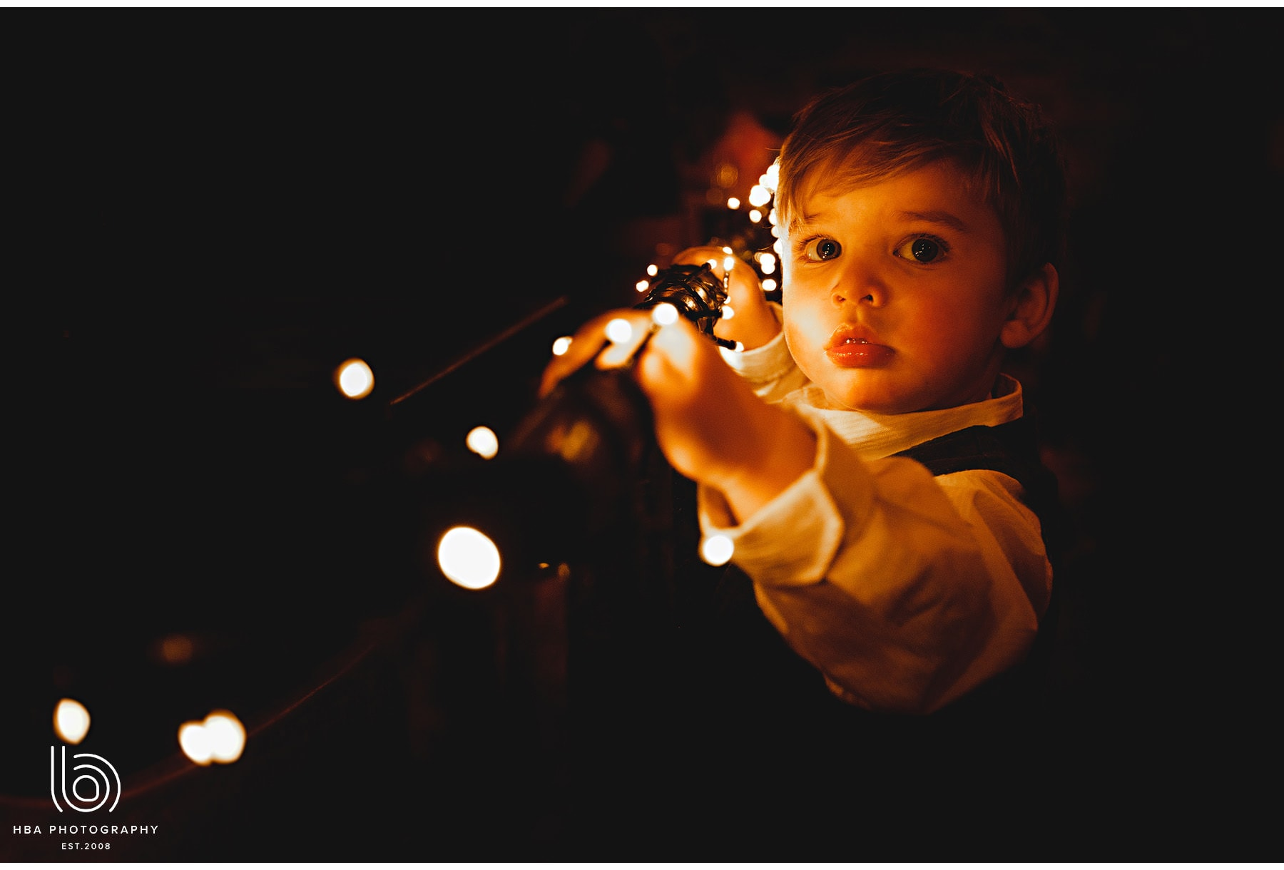 a child playing with the fairy lights