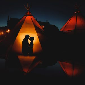 an orange tipi wedding photo