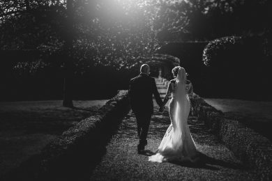 The bride and groom walking off into the distance at Stapleford Park in Nottinghamshire