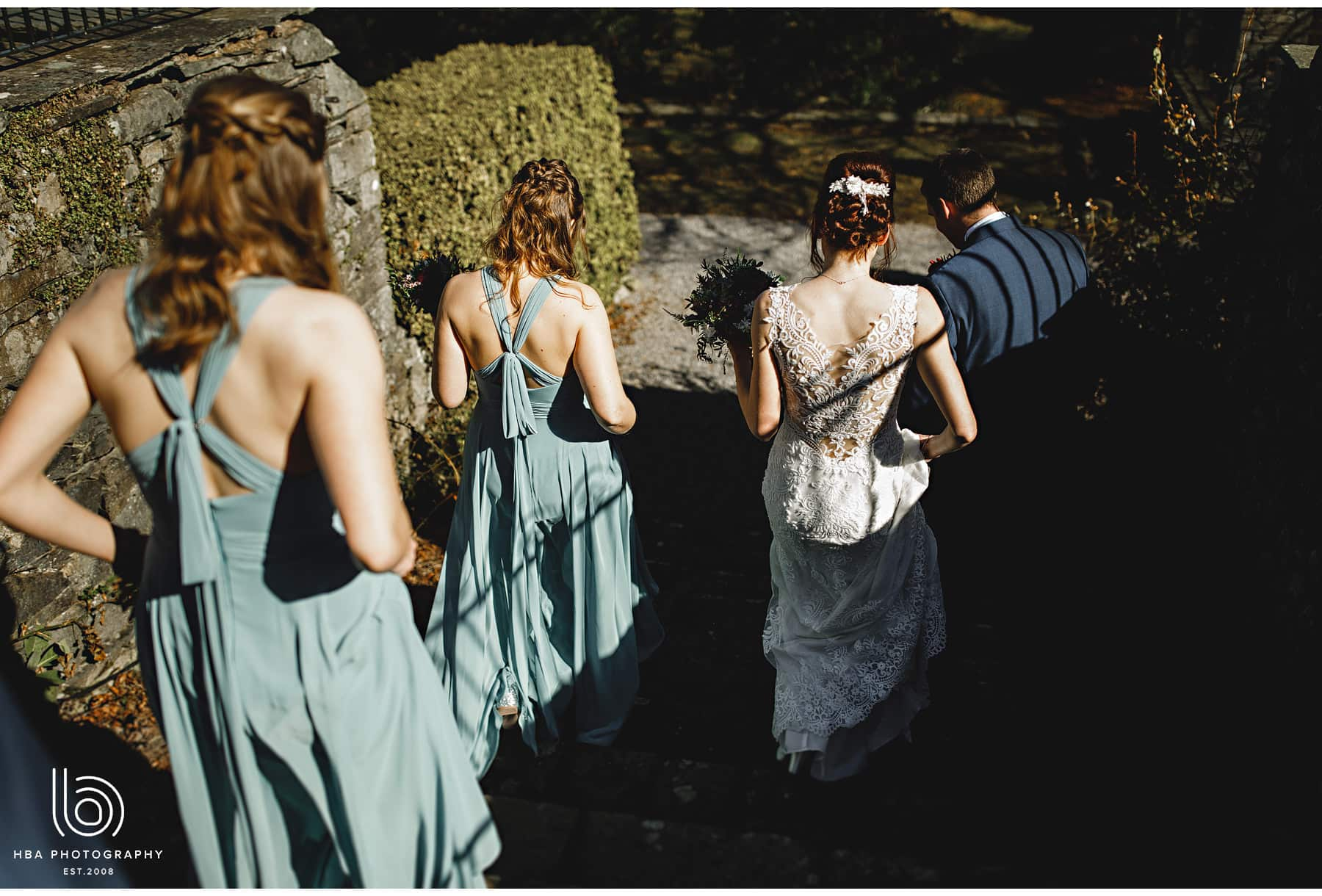 the bridal party walking through the estate