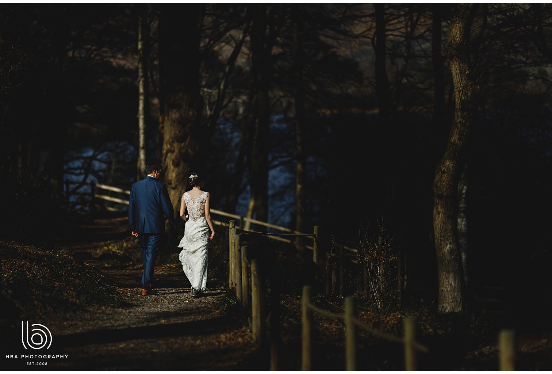the bride & groom walking down to Derwent Water
