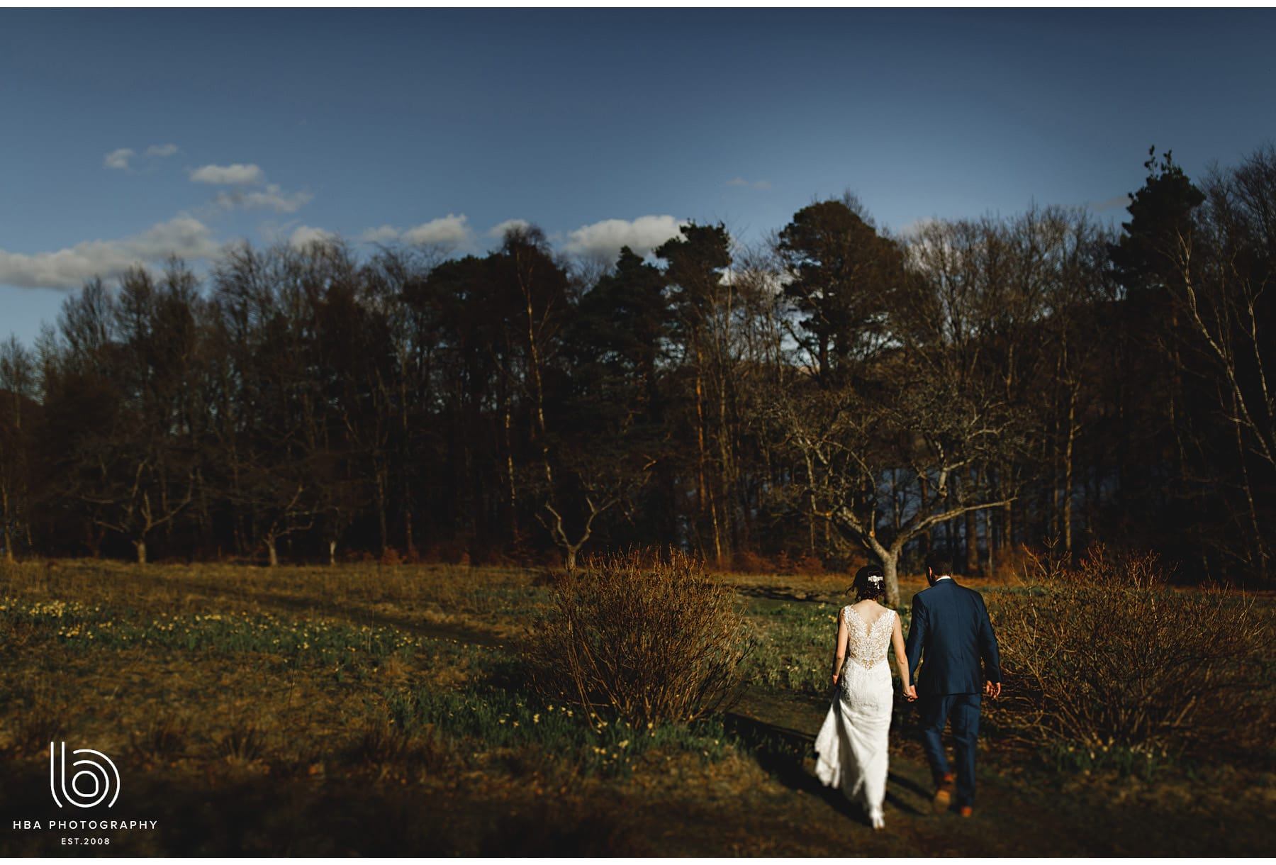 the bride & groom walking in the estate