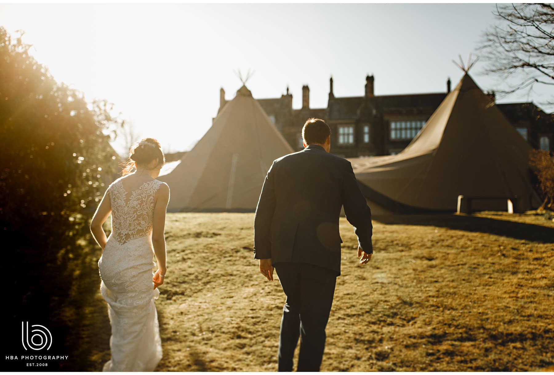 the bride & groom walking back to the tipi