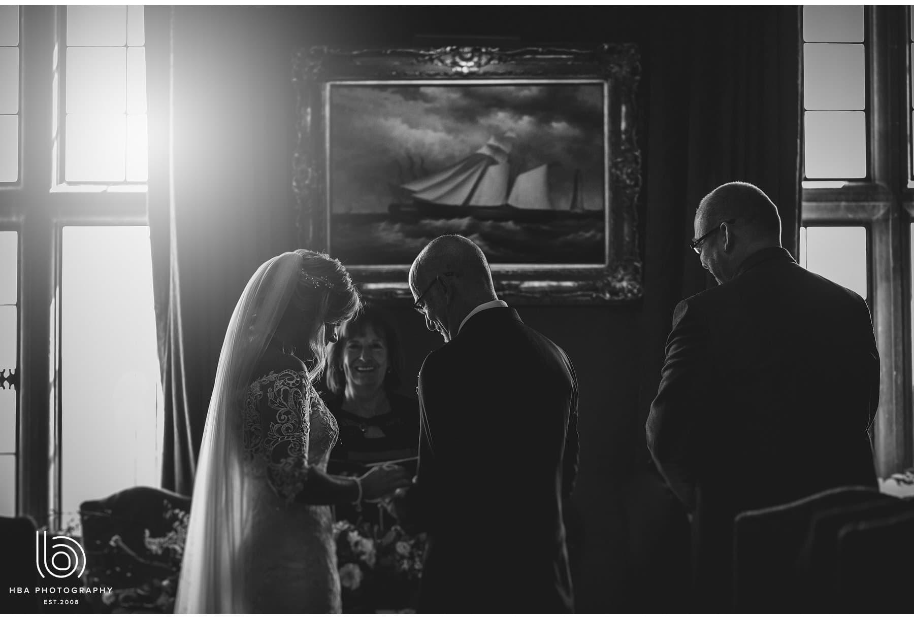 the bride & groom exchanging rings