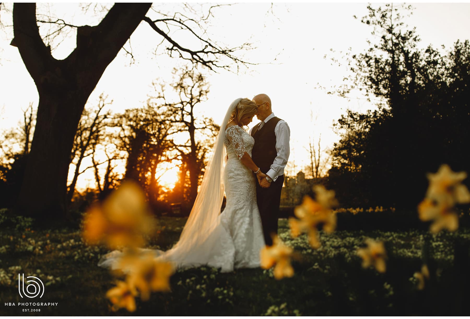 the bride & groom in the daffs in golden hour