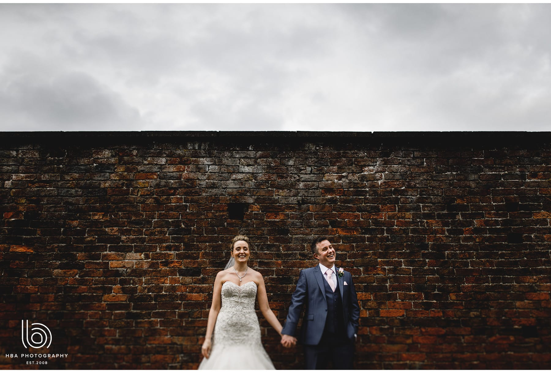 the bride & groom against the walls