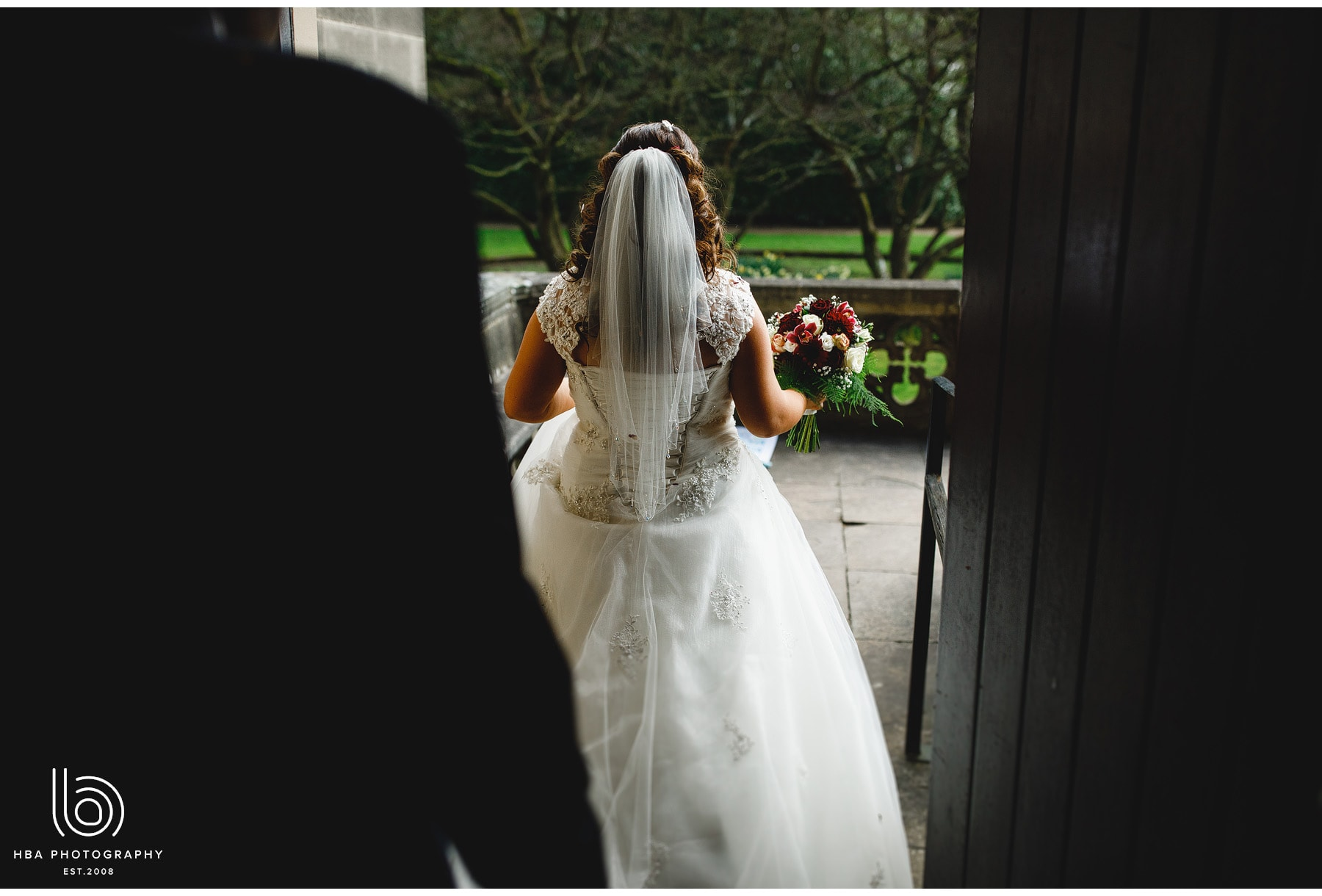 the bride walking into the gardens