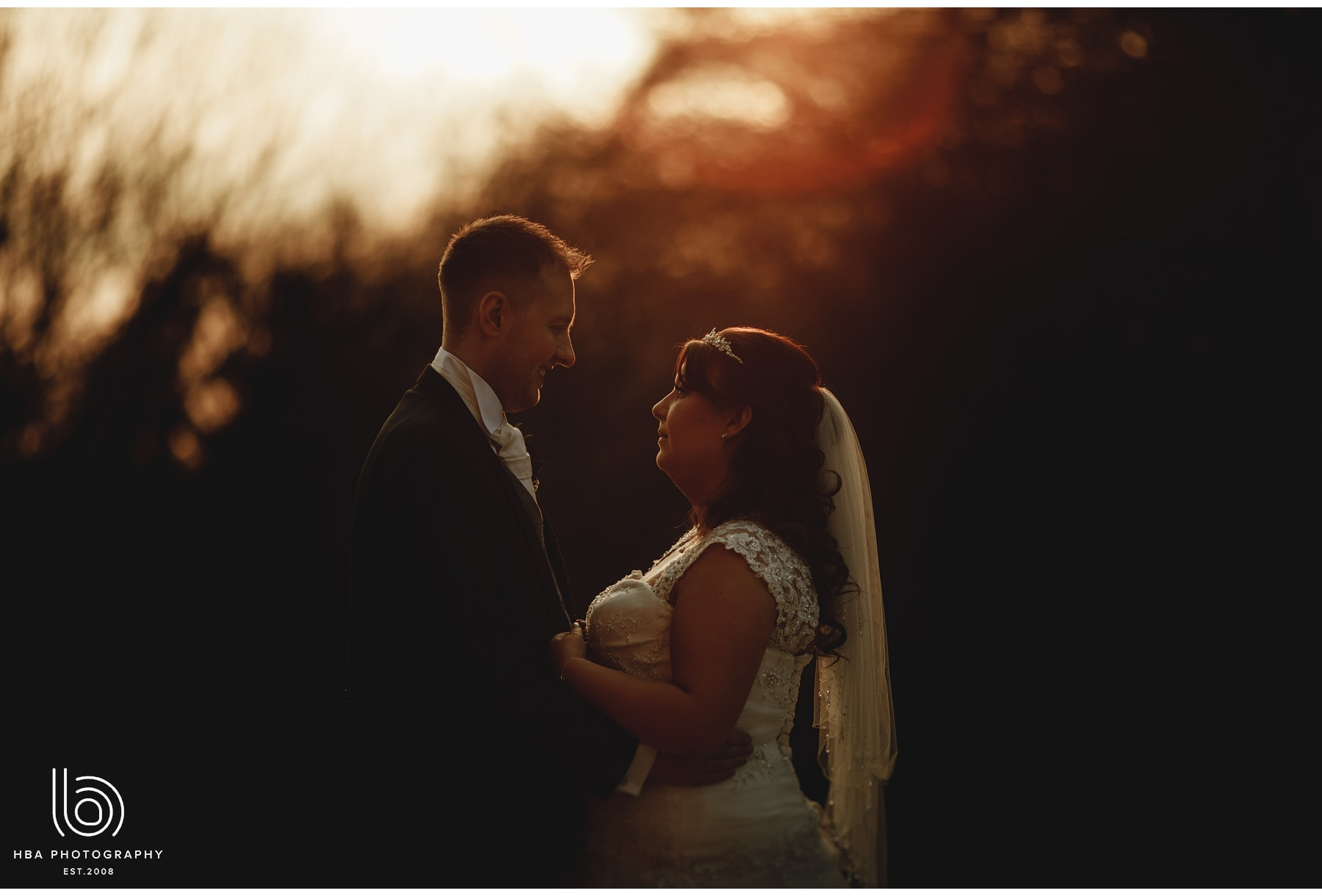 the bride and groom at dusk