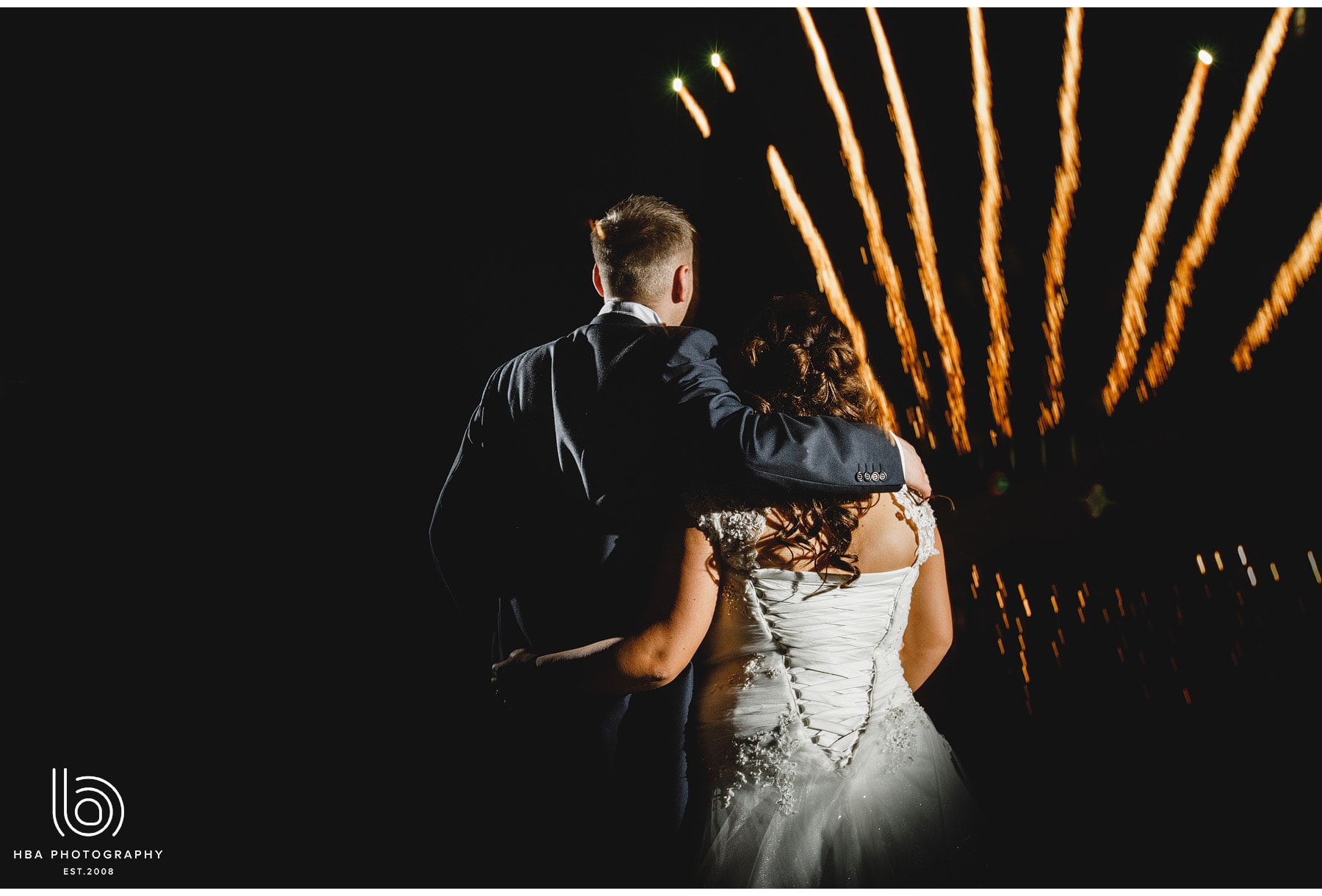 bride and groom and the fire works