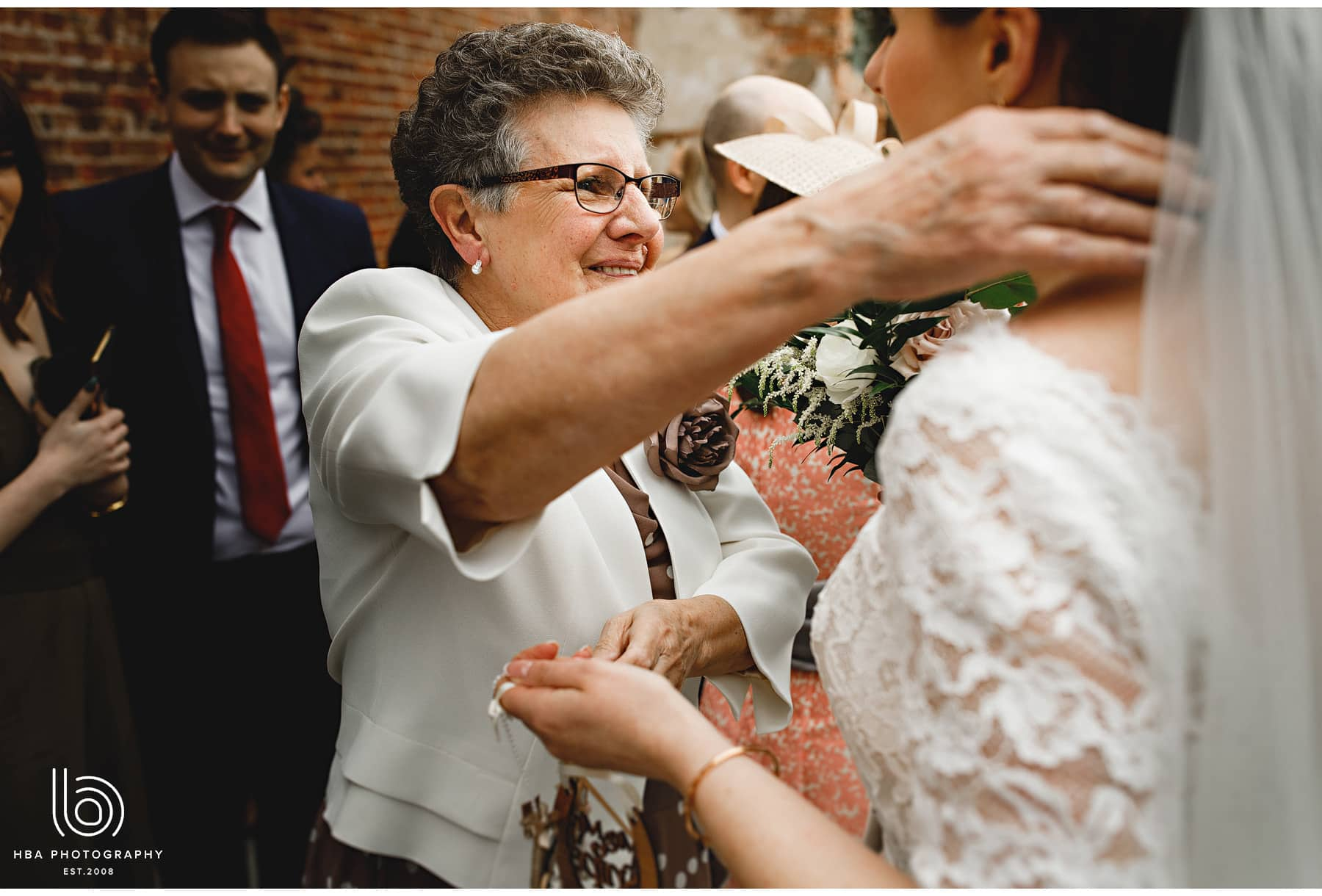 grandma hugging the bride