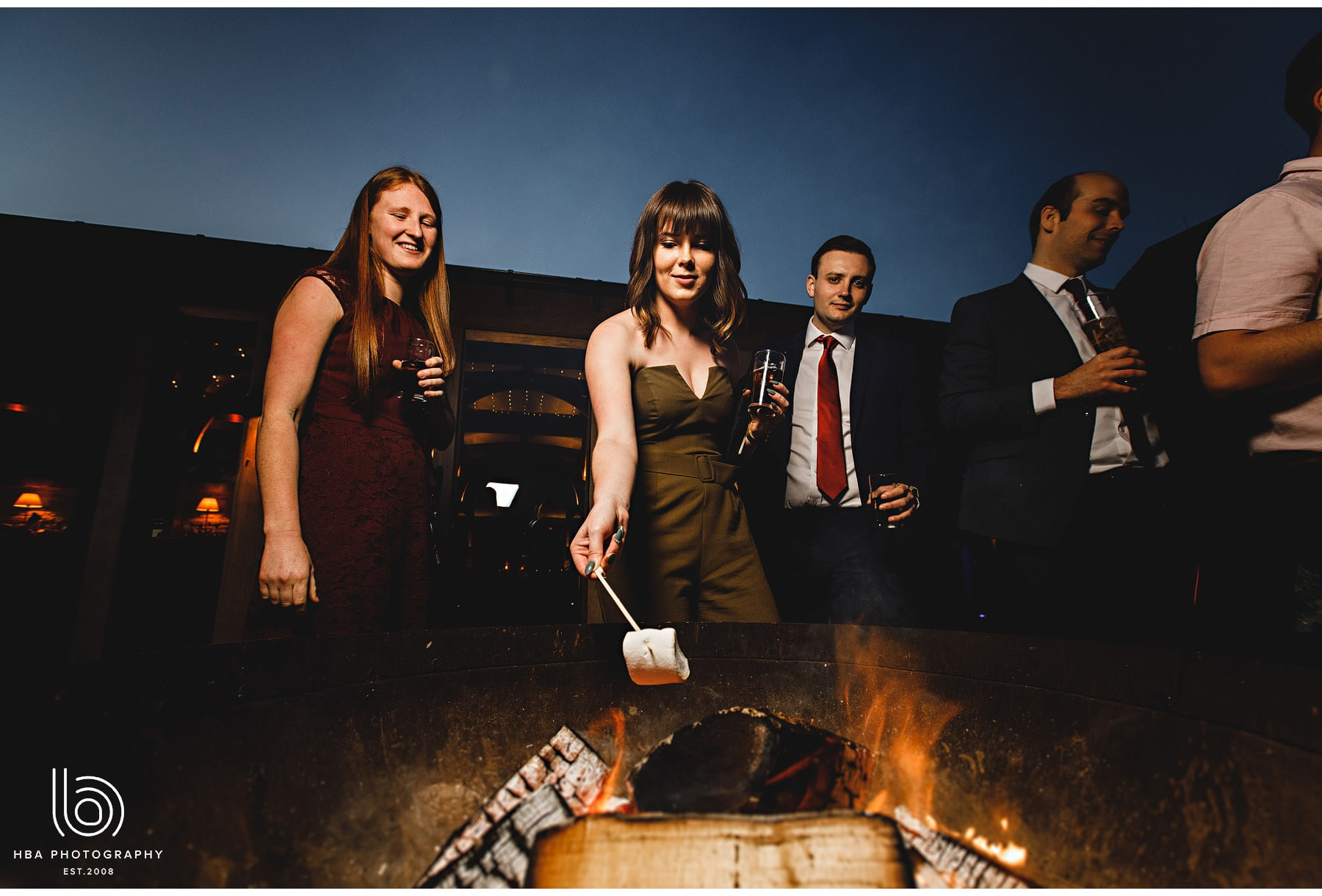 wedding guests toasting marshmallows