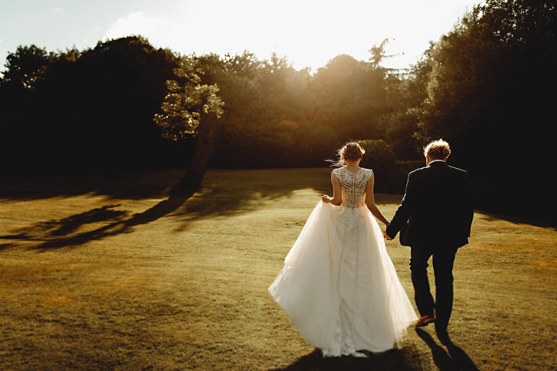 the bride and groom in the golden hour sunlight at Newton House Barns on their wedding day in Derbyshire