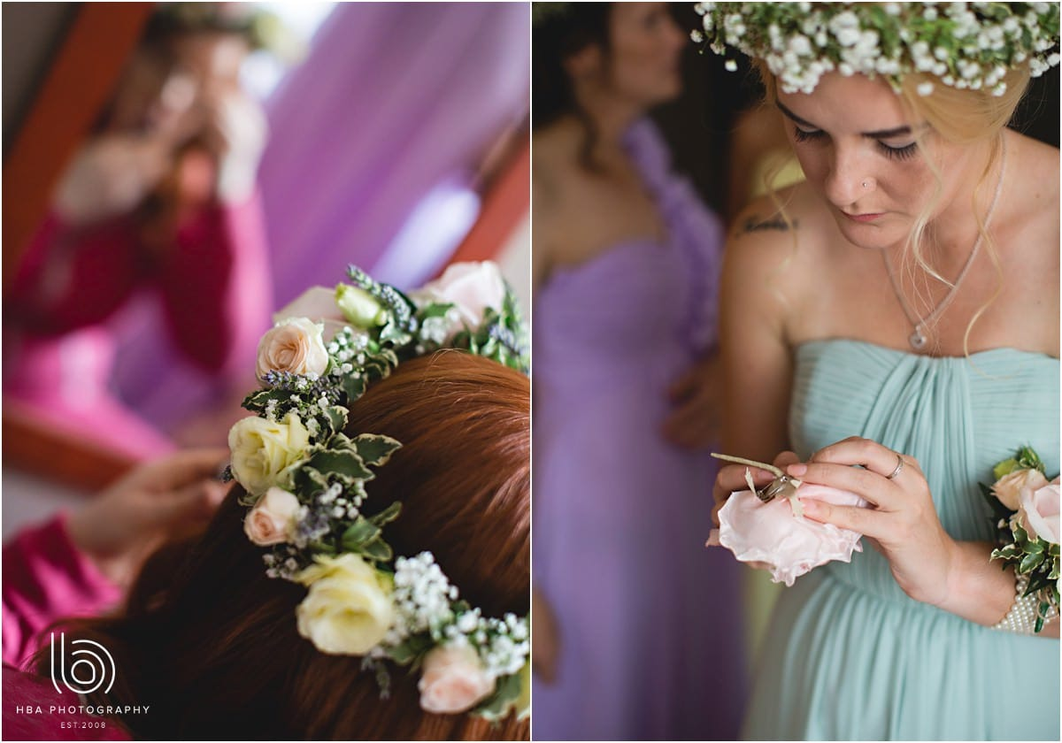 bride and bridesmaid gettgin ready with flower crowns in their hair