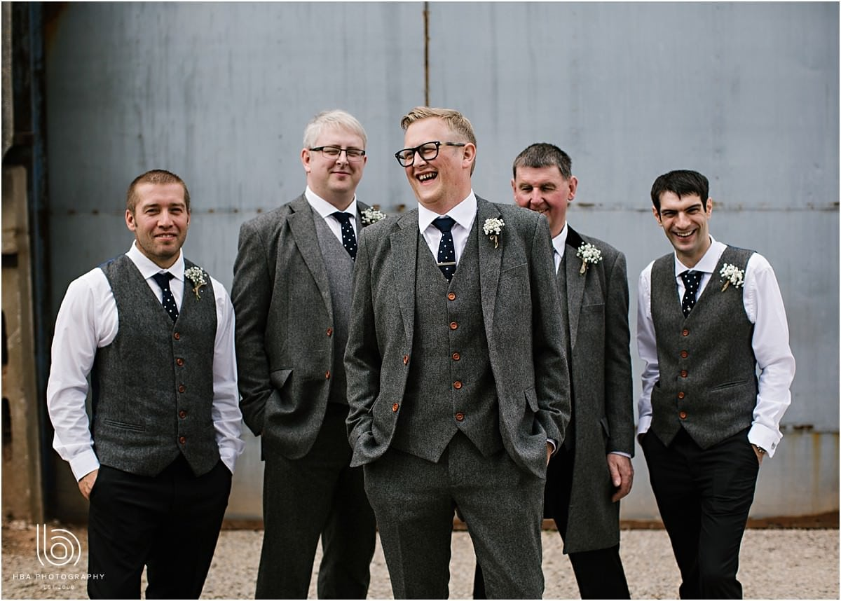 the groom and groomsmen laughing