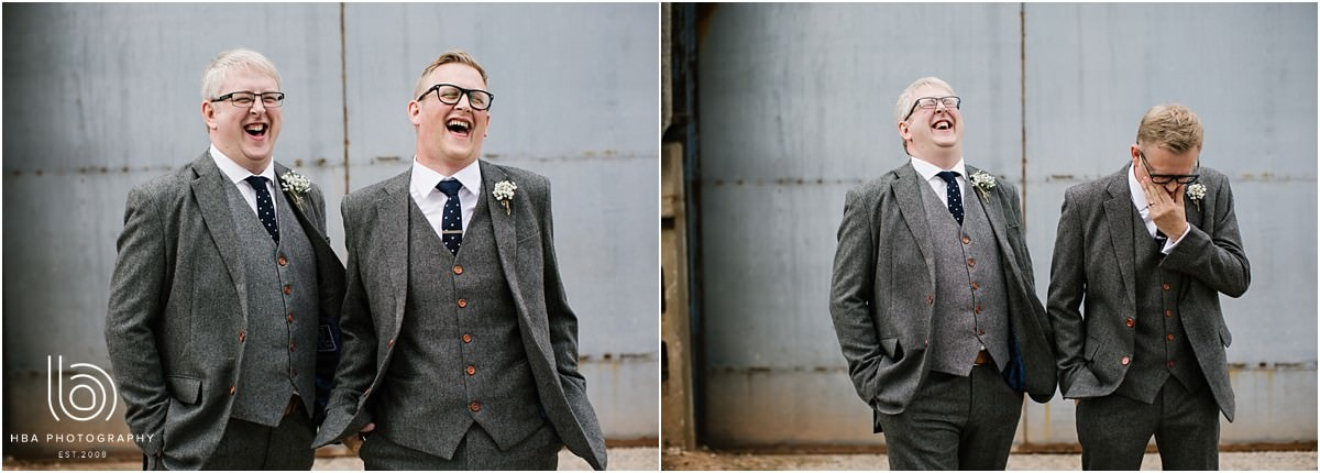 the groom and his brither in tweed grey suits, laughing