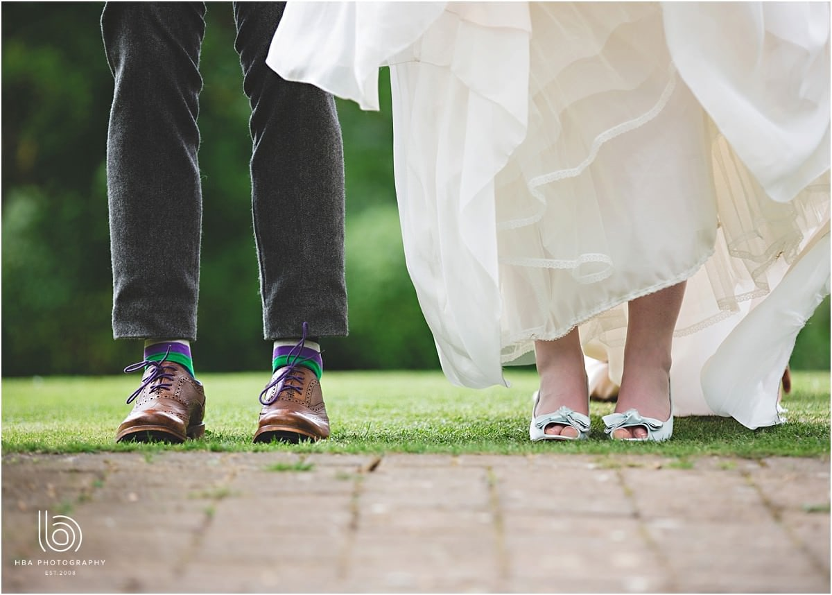 a picture of the bride and grooms wedding shoes