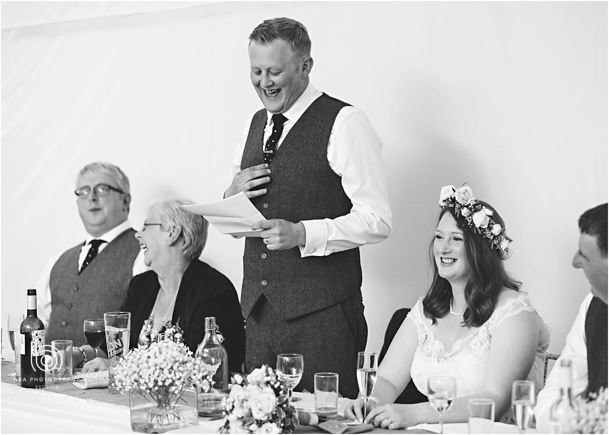 black and white photos of the groom giving his speech