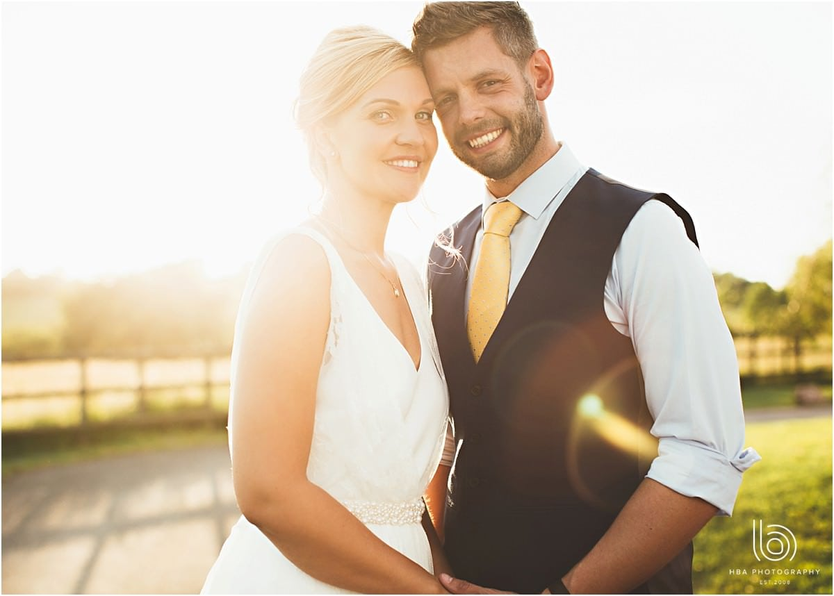 the bride and groom with sun flare