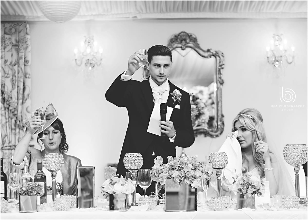 the groom gibing his speech at the wedding