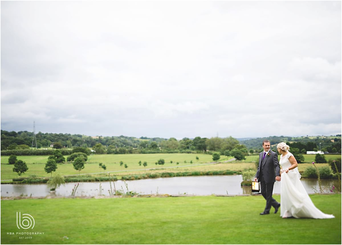the bride and groom with a view of the lake