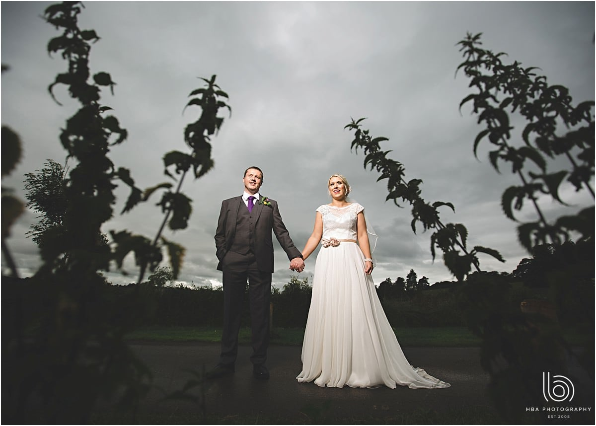 a dramatic shot of the bride and groom with grey skies