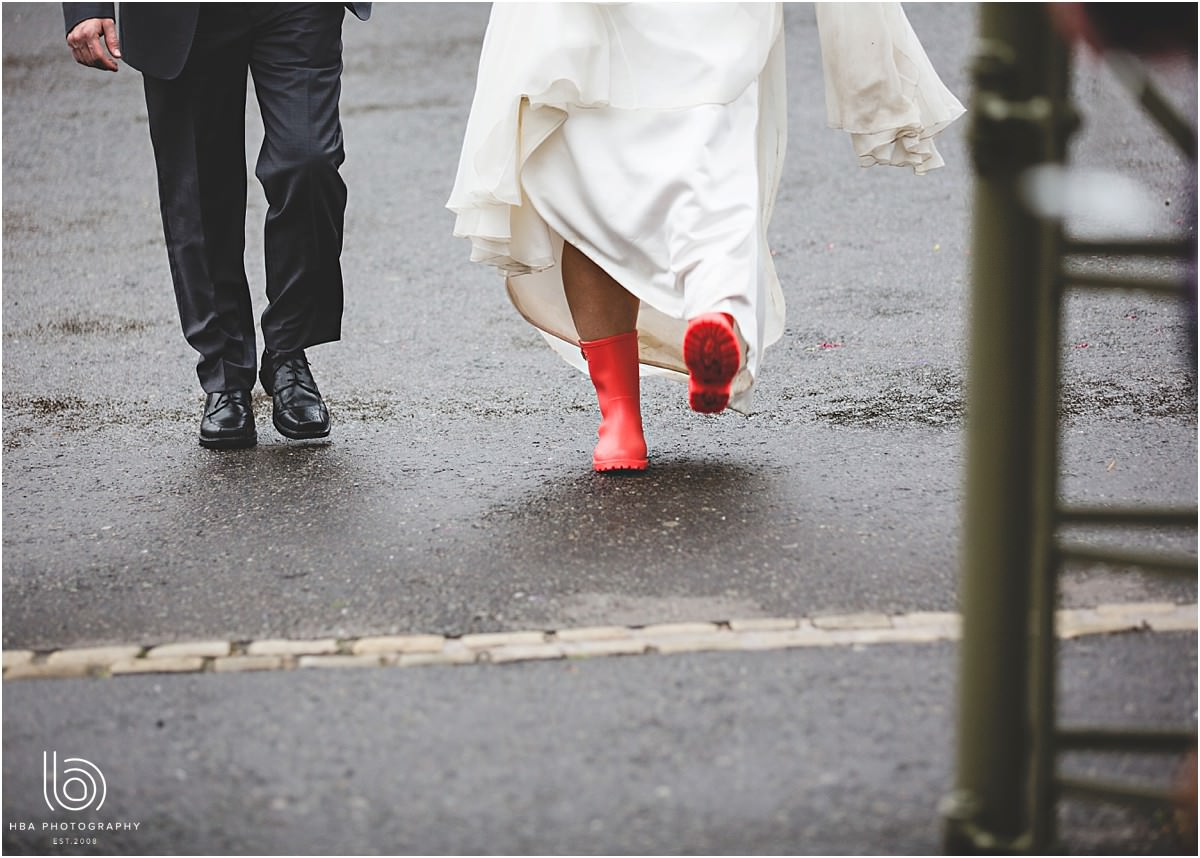 the bride in her red wellies