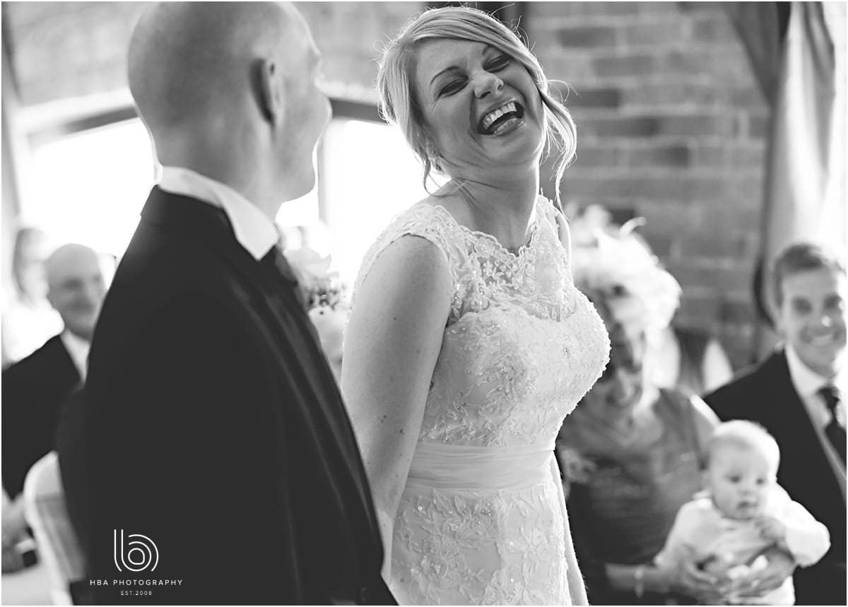the bride laughing at the groom