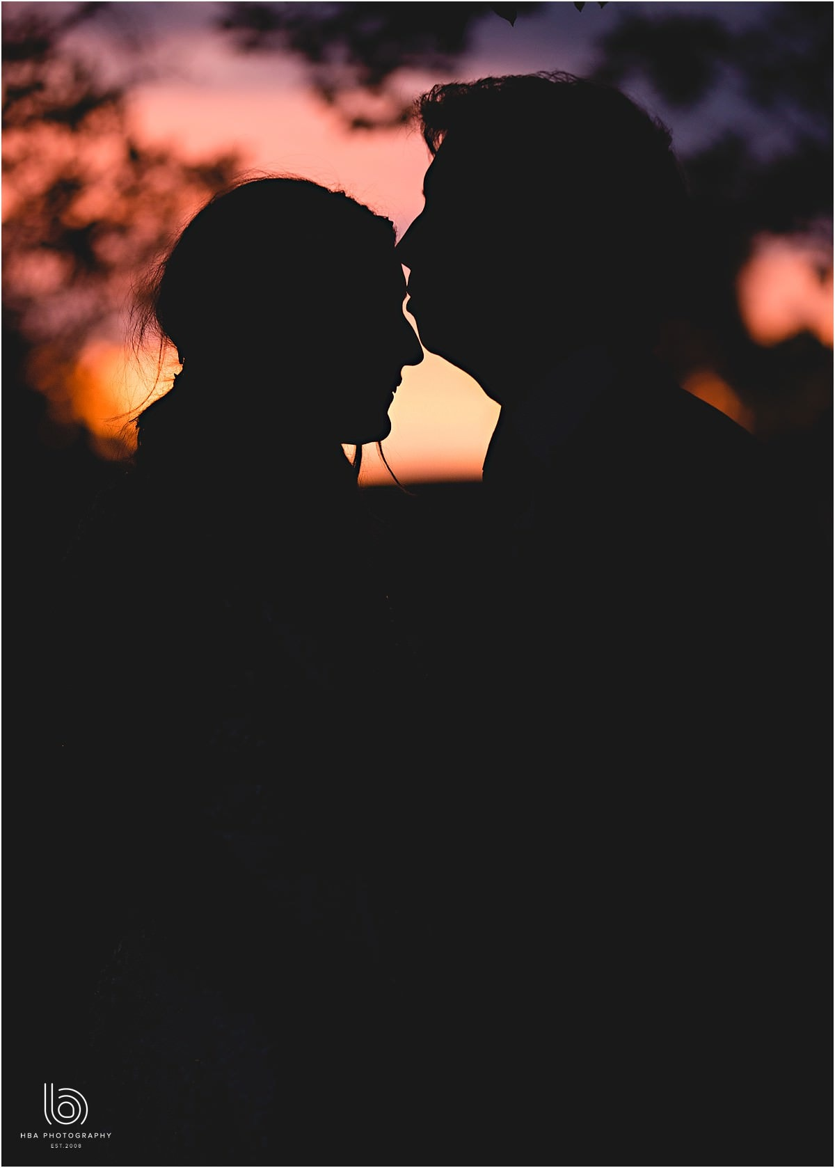 the bride and groom in silhoutte by HBA Photography