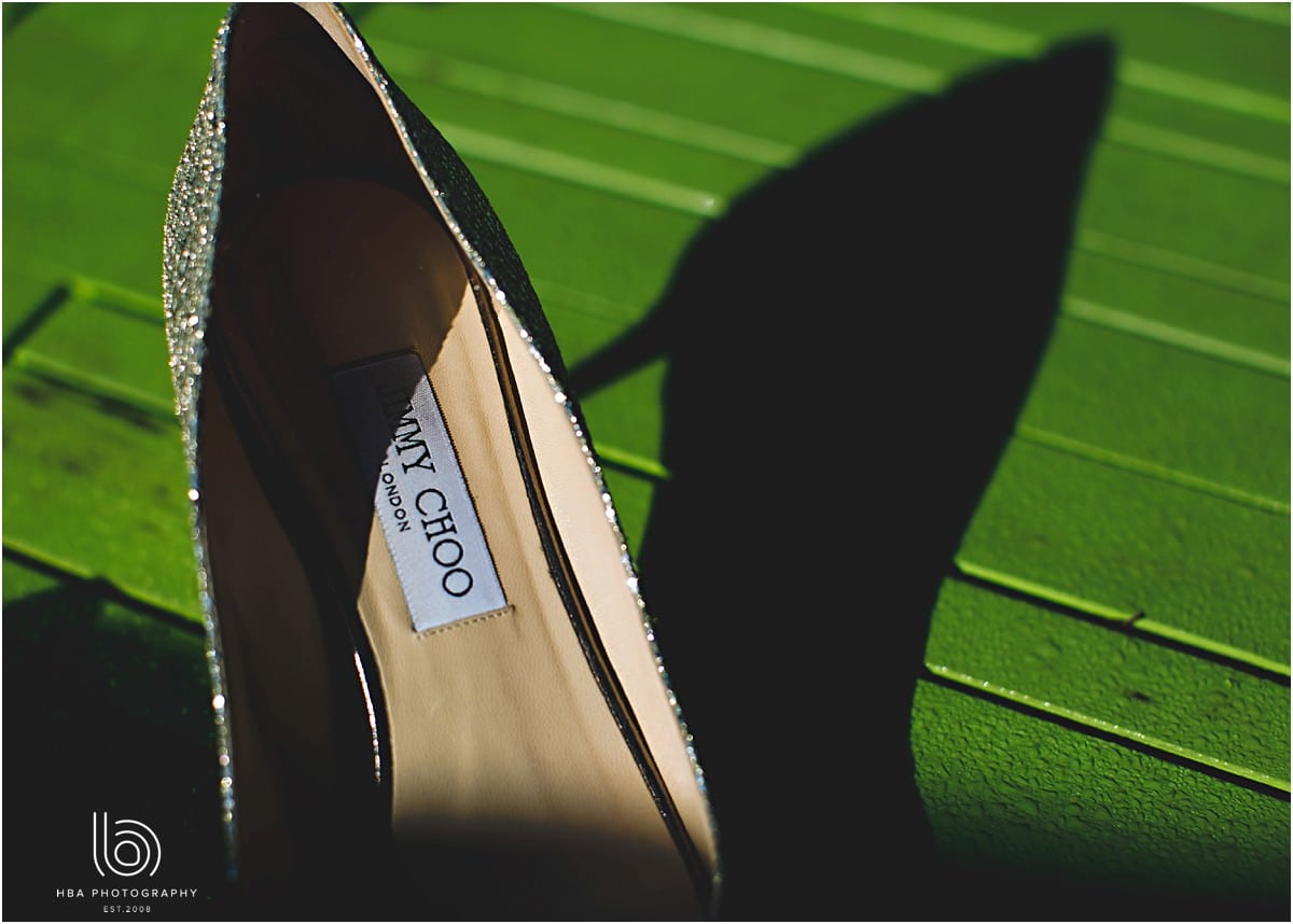 jimmy choo wedding shoes on a green background