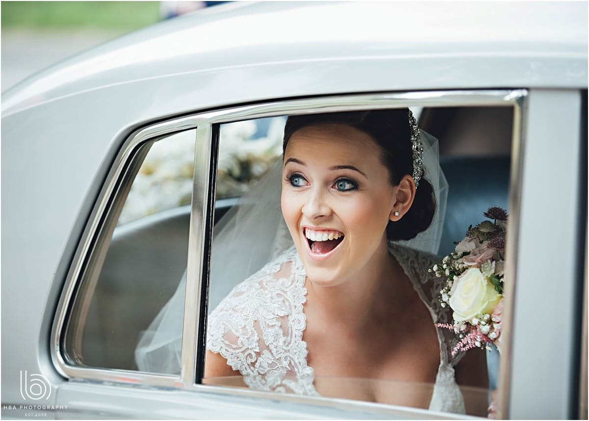 the bride arriving in the car smiling