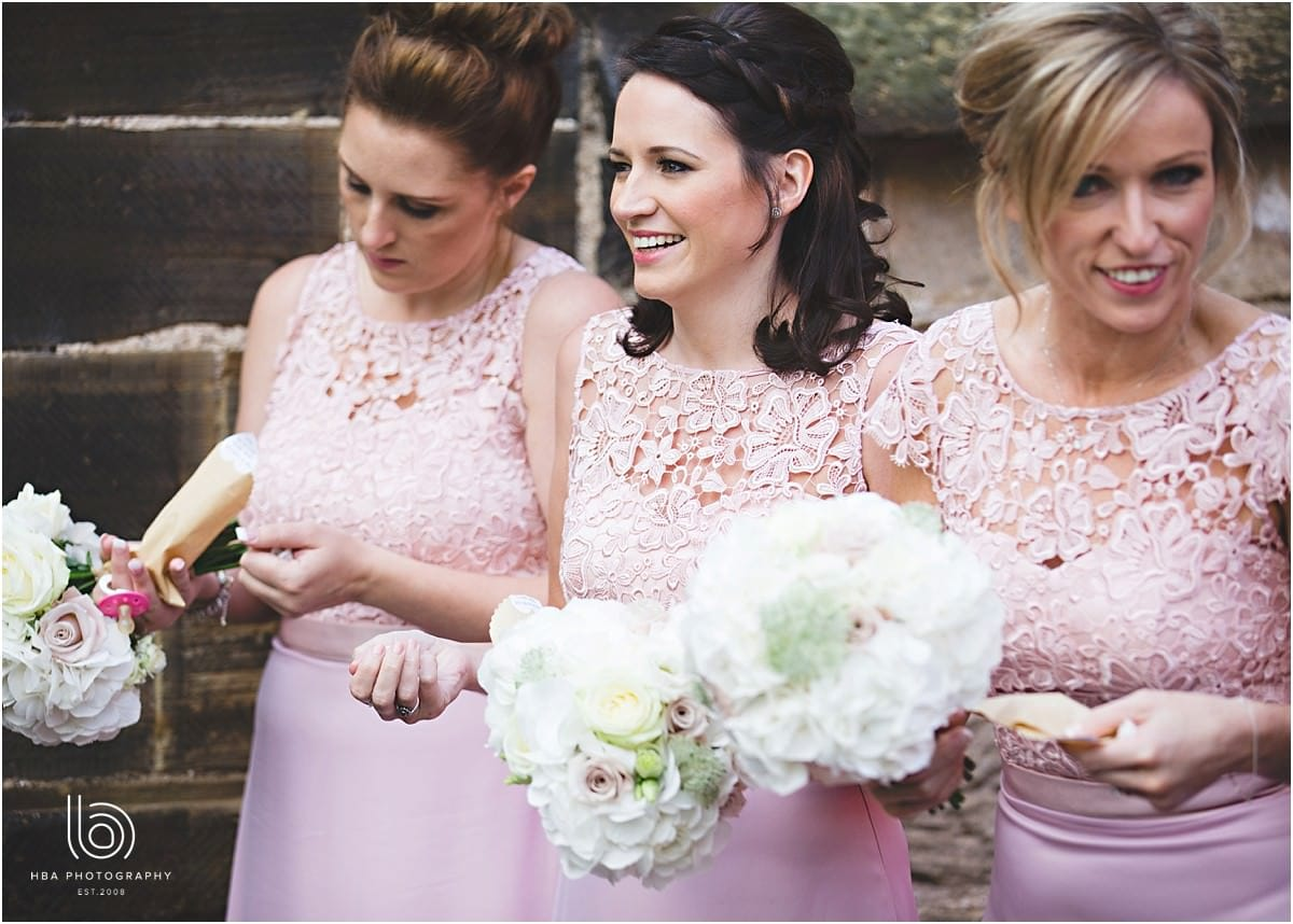 the bridesmaids in pink holding confetti