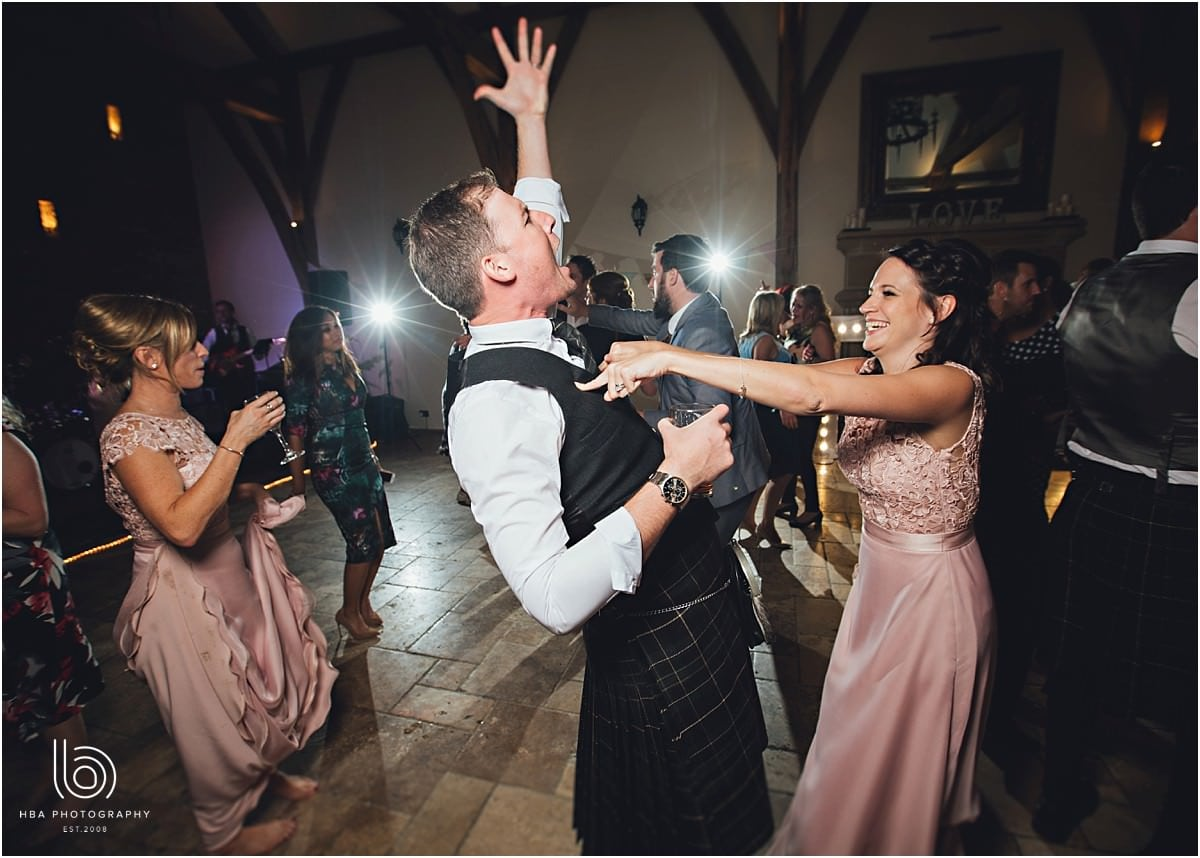 the groom and bridesmaids dancing