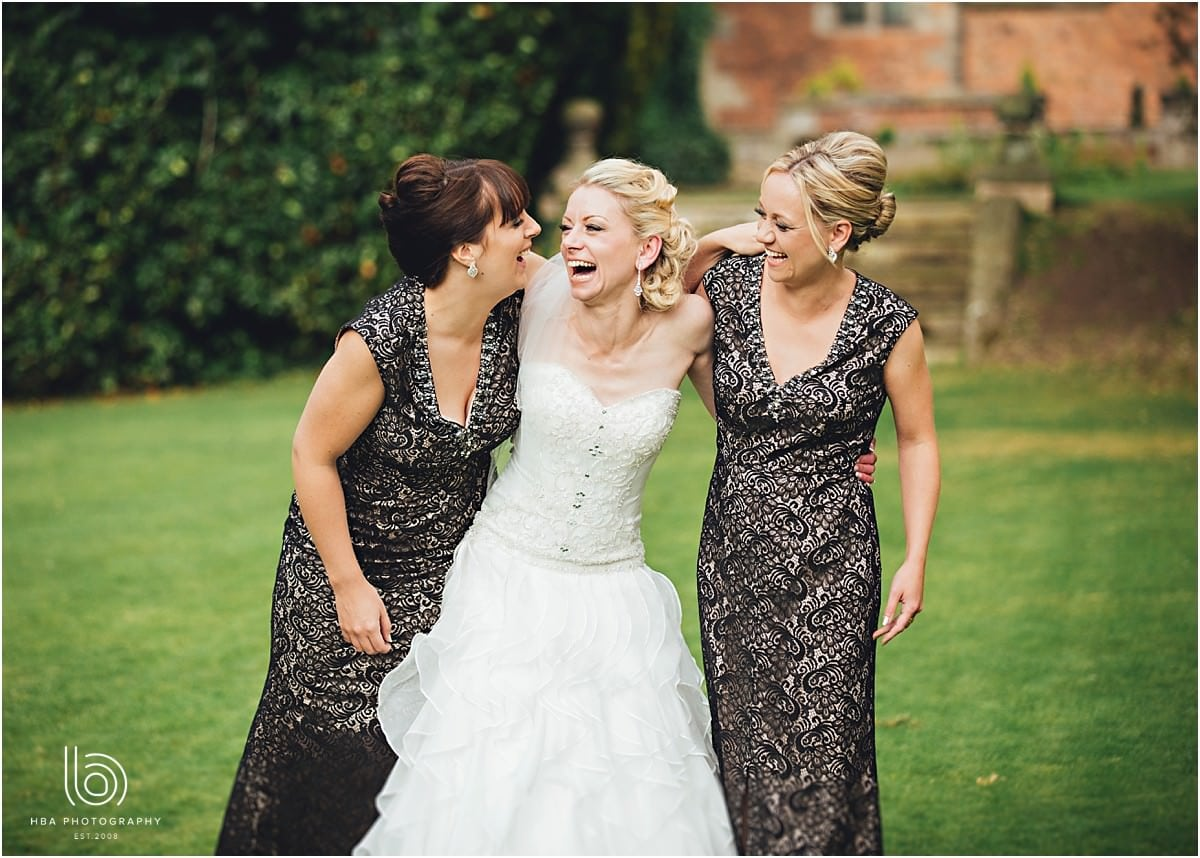 the bride laughing with her bridesmaids