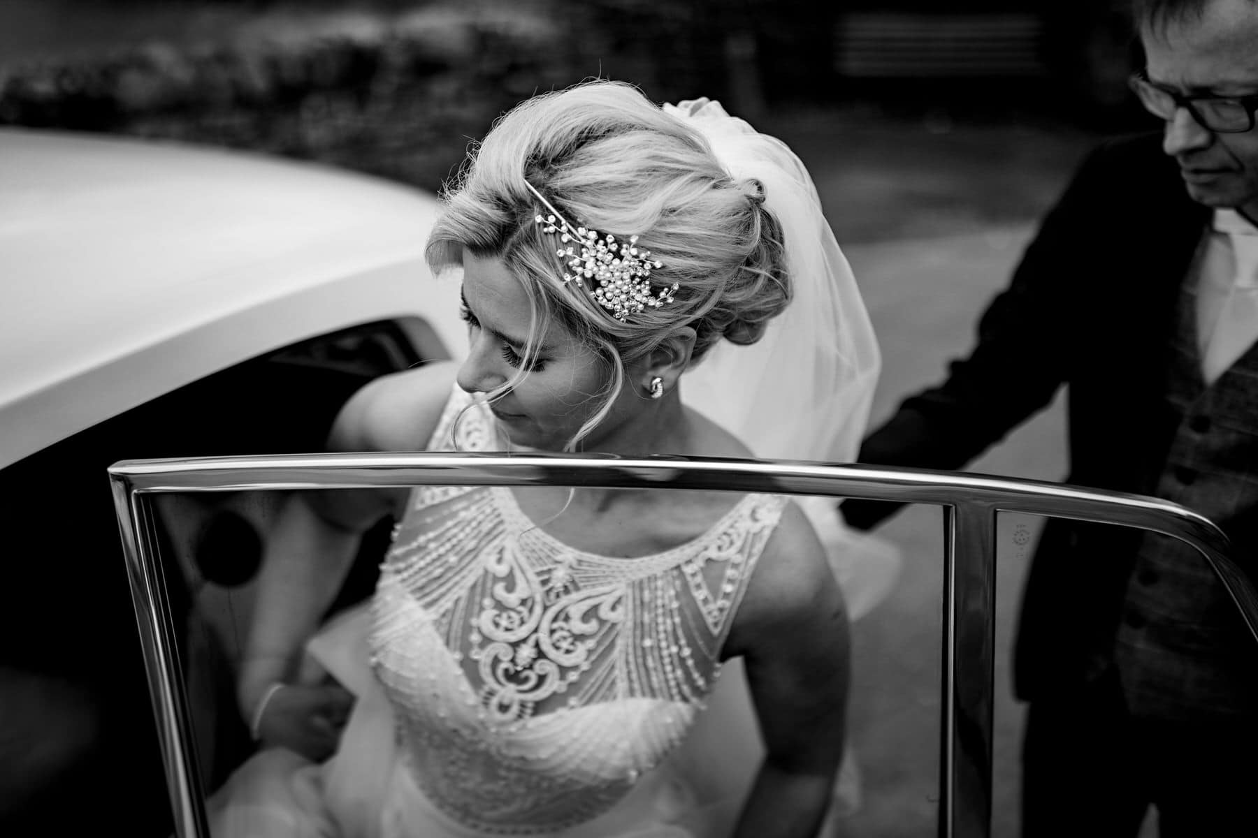 the bride arriving at The west mill in the wedding car