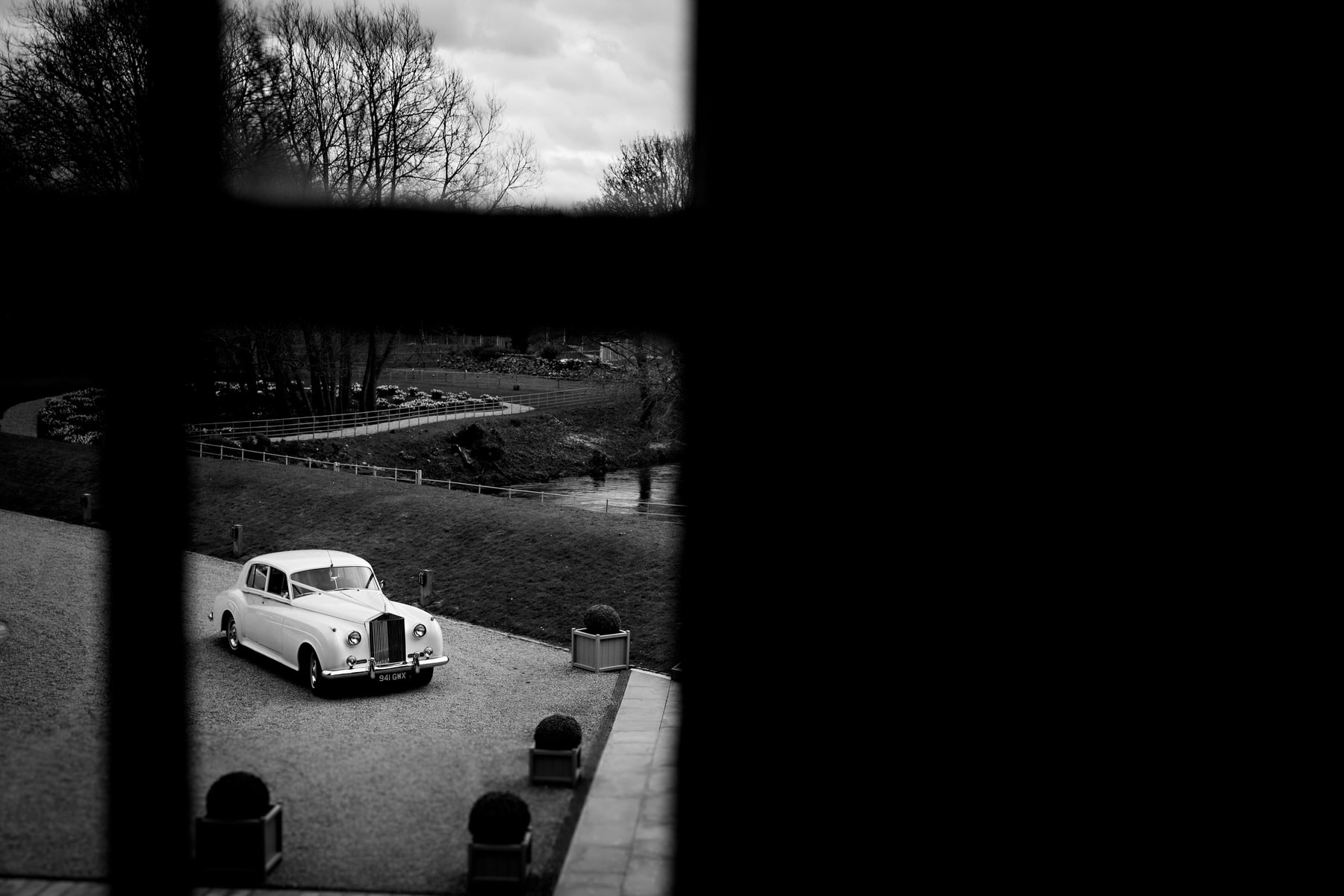 wedding car arrival in black and white