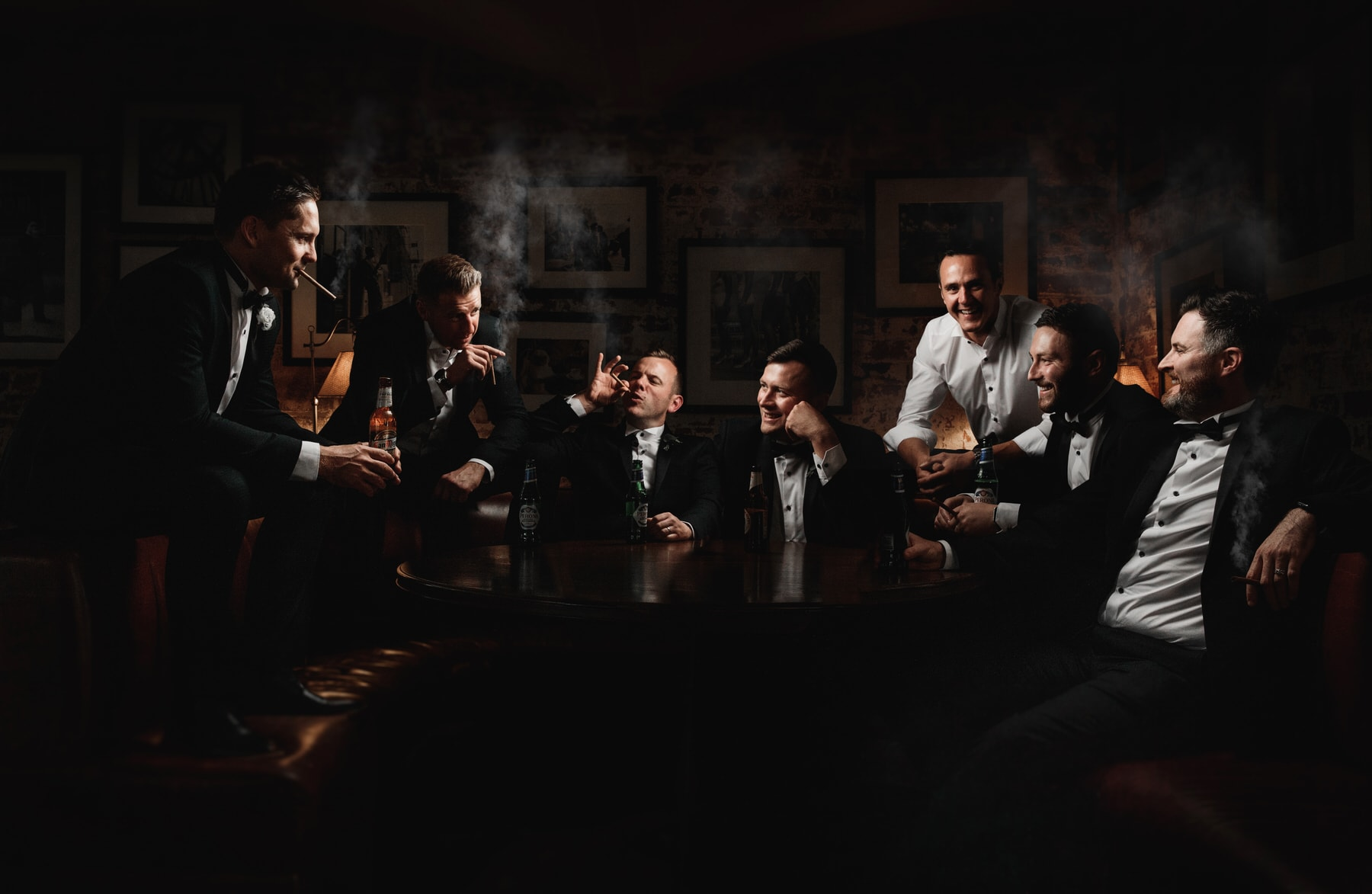 a dark and moody groomsman photo at the west mill