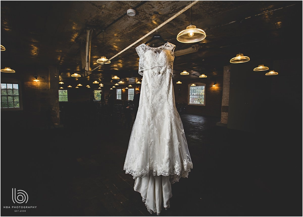 the brides dress hanging in one of the rooms