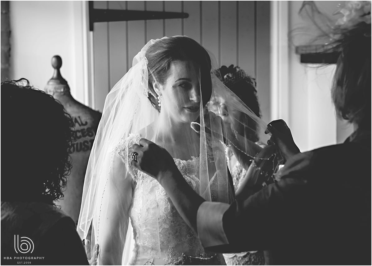 the bride with the veil over her face
