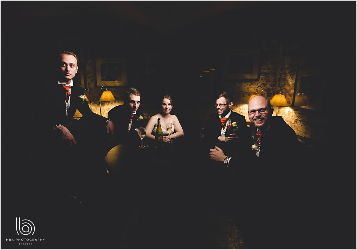 a moody shot of the wedding party